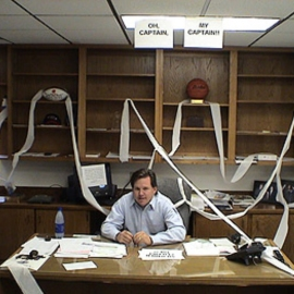 CEO-Brent-Richardson-on-the-first-day-on-the-job-at-the-desk-at-GCU-2004